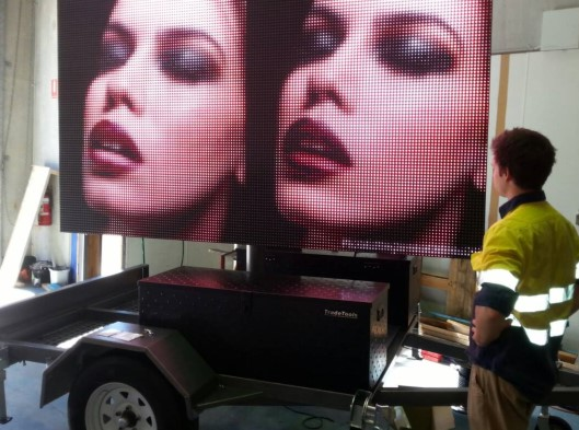 P16 LED trailer billboard for red rooster rockhampton showing womans face